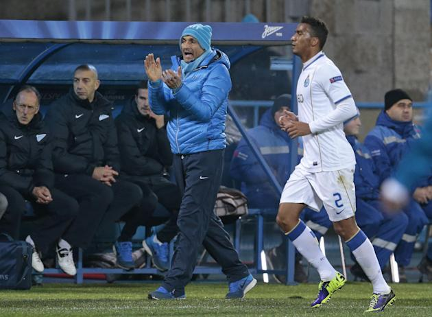 Zenit coach Luciano Spalletti, left, gestures during the Champions League group G soccer match between Zenit and Porto at Petrovsky stadium in St.Petersburg, Russia, on Wednesday, Nov. 6, 2013
