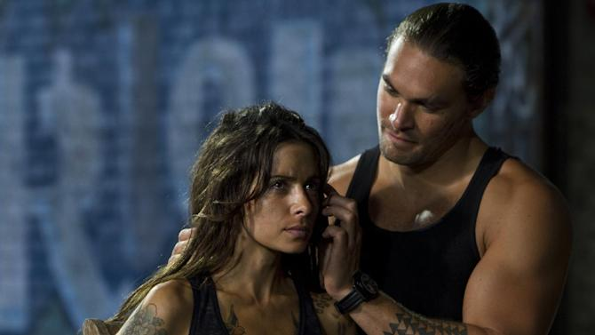 """This film image released by Warner Bros. Pictures shows Sarah Shahi, left, and Jason Momoa in a scene from """"Bullet to the Head."""" (AP Photo/Warner Bros. Pictures, Frank Masi)"""
