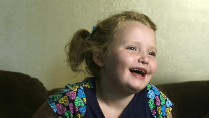 "FILE - In this Sept. 10, 2012 file photo, seven-year-old beauty pageant regular and reality show star Alana ""Honey Boo Boo"" Thompson gestures during an interview in her home in McIntyre, Ga. (AP Photo/John Bazemore, file)"