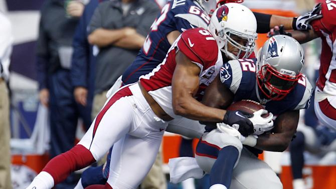 Arizona Cardinals linebacker Paris Lenon (51) tackles New England Patriots running back Stevan Ridley (22) in the first quarter of an NFL football game on Sunday, Sept. 16, 2012, in Foxborough, Mass. (AP Photo/Stephan Savoia)
