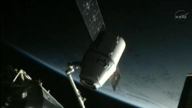 This framegrab image from NASA-TV shows the SpaceX Dragon capsule just after the capsule is backed away from the International Space Station and being repositioned for release later Thursday morning May 31, 2012. The Dragon capsule is scheduled for splashdown at 11:44 a.m. EDT Thursday in the Pacific Ocean. (AP Photo/NASA)