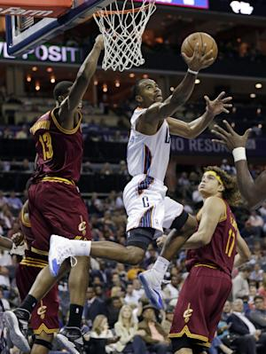 Kemba Walker helps Bobcats beat Cavs 90-84