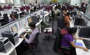 File picture shows employees at their workstations on the floor of an outsourcing centre in Bangalore