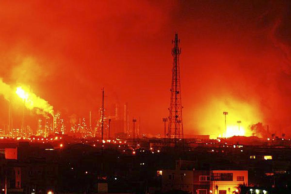 Fire rises over the Amuay refinery near Punto Fijo, Venezuela, Saturday, Aug. 25, 2012. A huge explosion rocked Venezuela's biggest oil refinery, killing at least 24 people and injuring dozens, an official said. (AP Photo/Daniela Primera)