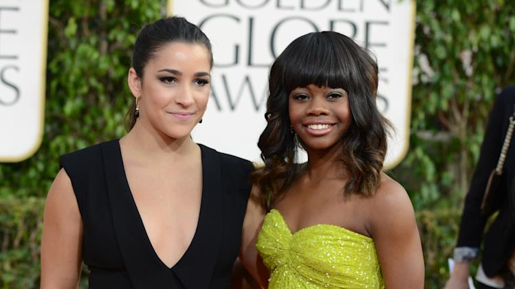 Olympic gymnasts Aly Raisman, left, and GabbyDouglas arrive at the 70th Annual Golden Globe Awards at the Beverly Hilton Hotel on Sunday Jan. 13, 2013, in Beverly Hills, Calif. (Photo by Jordan Strauss/Invision/AP)