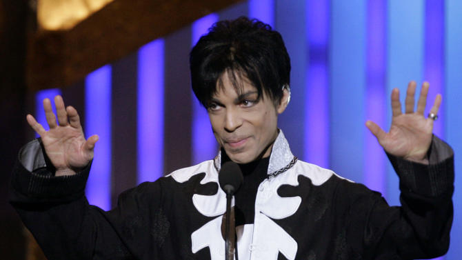 """FILE - In this March 2, 2007 file photo, Prince accepts an award during the NAACP Image Awards in Los Angeles. He is scheduled to appear on """"Late Night with Jimmy Fallon."""" A rep for the late-night talk show confirmed the pop legend will appear on the show Friday, March 1, 2013, and perform two songs. (AP Photo/Chris Carlson, file)"""