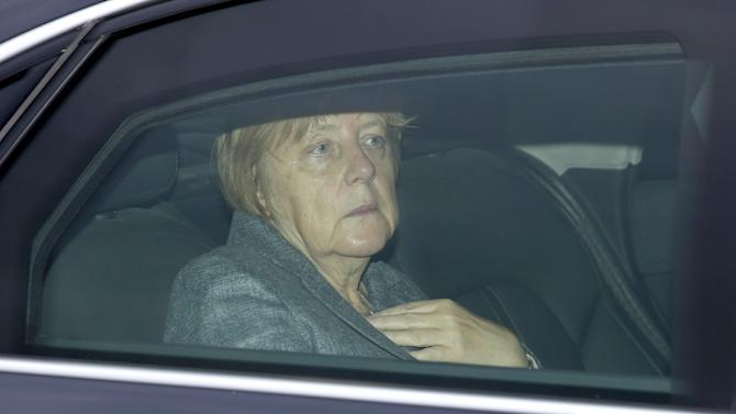 German Chancellor Angela Merkel sits in her limousine as she arrives at the Chancellery in Berlin, Germany