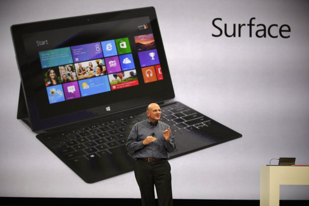 Microsoft CEO Steve Ballmer unveils &quot;Surface&quot;, a new tablet computer to compete with Apple&#39;s iPad, at Hollywood&#39;s Milk Studios in Los Angeles Monday, June 18, 2012. The 9.3 millimeter thick tablet comes with a kickstand to hold it upright and keyboard that is part of the device&#39;s cover. It weighs under 1.5 pounds. (AP Photo/Damian Dovarganes)