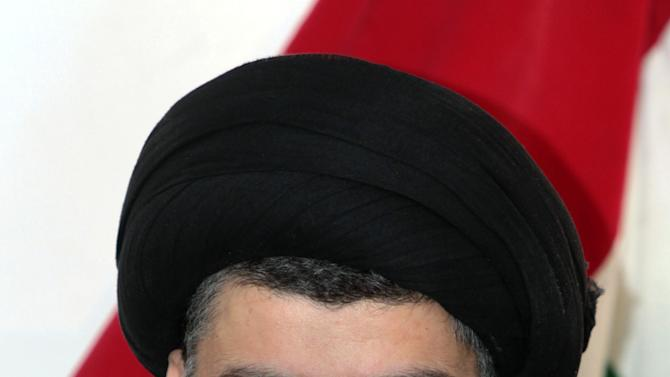 Shiite cleric Muqtada al-Sadr speaks during a press conference in the Shiite holy city of Najaf, 100 miles (160 kilometers) south of Baghdad, Iraq, Tuesday, Jan 1, 2013. The anti-American cleric Muqtada al-Sadr voiced support for Iraqi Sunni protesters who have been rallying against the country's Shiite-dominated central government and said the demonstrators have the right to demonstrate as long as they are peaceful. (AP Photo/ Alaa al-Marjani)