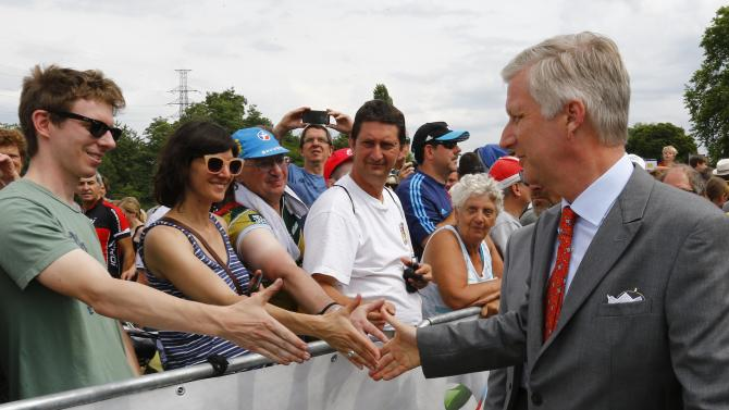 Belgium's King Philippe shakes hands with supporters before the start of the 4th stage of the 102nd Tour de France cycling race from Seraing to Cambrai