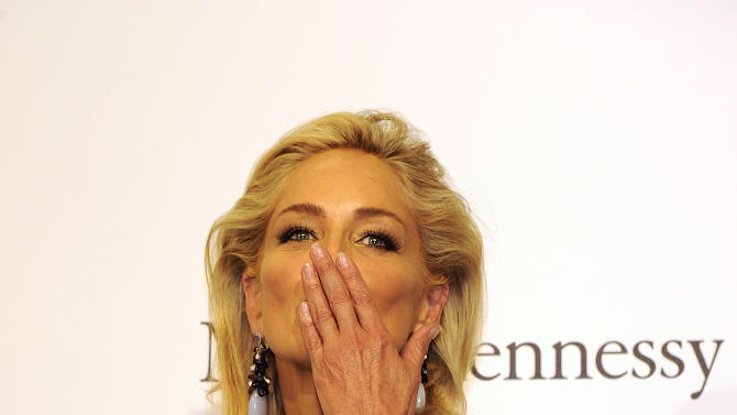USA  Actress Sharon Stone blows a kiss as she arrives at the Amfar charity event, part of the Fashion Week in Milan, Italy, Saturday, Sept. 22, 2012. (AP Photo/Giuseppe Aresu)