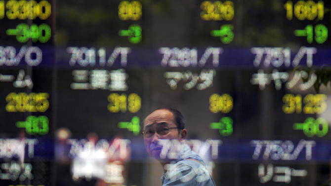 A man looks at the electronic stock board of a securities firm in Tokyo Friday, June 8, 2012. Asian stock markets fell Friday, deflated after U.S. Federal Reserve Chairman Ben Bernanke gave no hint of immediate action to jump-start growth in the world's No. 1 economy. Japan's Nikkei 225 index fell 2 percent to 8,471.04. (AP Photo/Itsuo Inouye)