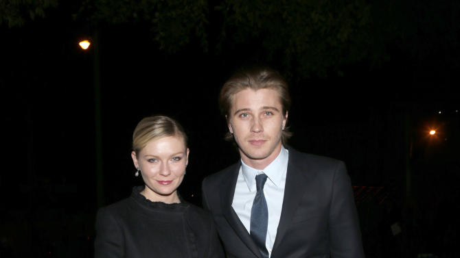 Kirsten Dunst and Garrett Hedlund attend the W Magazine's Best Performances and Golden Globe Awards Party Presented by Cadillac, on Friday, January, 11, 2013 in Los Angeles. (Photo by Todd Williamson/Invision for Cadillac/AP Images)