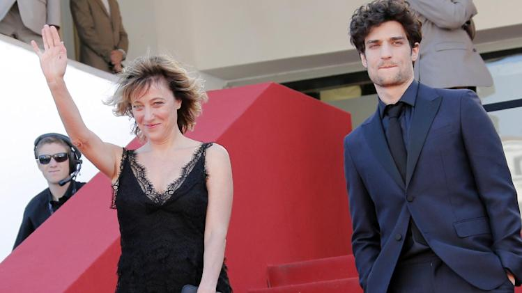 Director Valeria Bruni Tedeschi, left, and Louis Garrel stand at the top of the red carpet as they arrive for the screening of A Castle in Italy at the 66th international film festival, in Cannes, southern France, Monday, May 20, 2013. (AP Photo/Francois Mori)
