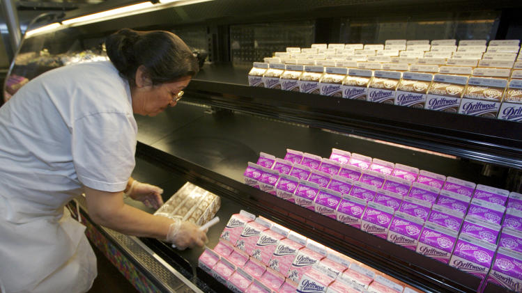 In this photo taken Tuesday, May 3, 2011, cafeteria manager Carol Avalos sorts individual milk cartons at the Belmont Senior High cafeteria in Los Angeles. With schools under increasing pressure to combat child obesity by offering healthier food, the national staple of kids' cafeteria trays has come under attack over the very ingredient that helps make it so popular, sugar. (AP Photo/Damian Dovarganes)
