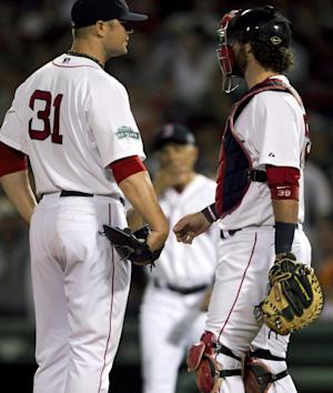 Boston Red Sox pitcher Jon Lester, left, talks with catcher Jarrod Saltalamacchia, as teams manager Bobby Valentine, center, approaches the mound to relieve Lester from the game in the fifth inning of a baseball game against the New York Yankees at Fenway Park in Boston, Sunday, July 8, 2012. (AP Photo/Steven Senne)