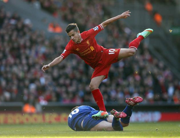 Liverpool's Coutinho challenges Cardiff City's Mutch during their English Premier League soccer match at Anfield in Liverpool, northern England