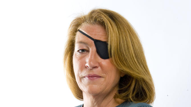 FILE - This undated file image made available Feb. 22, 2012 by the Sunday Times in London, shows journalist Marie Colvin. Funeral services for war correspondent Colvin will be held Monday, March 12, 2012, at St. Dominic Roman Catholic Church in Oyster Bay on New York's Long Island.  (AP Photo/Sunday Times, File)
