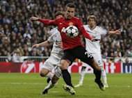 Manchester United&#39;s Robin van Persie keeps Real Madrid players at bay during the match in Madrid on February 13, 2013. Manchester City defender Pablo Zabaleta insists his side are determined to avoid becoming the latest high-profile victims of the FA Cup&#39;s giant-killing tradition when they face Leeds in the fifth round