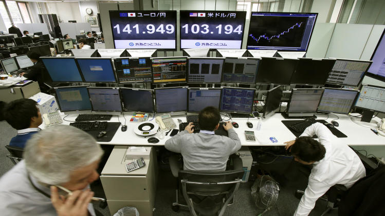 Money traders at a foreign exchange dealing company in Tokyo work as screens indicate the U.S. dollar, center, and euro, left, are traded higher against the Japanese yen Tuesday, Dec. 10, 2013. Asian stock markets were muted Tuesday amid some profit taking and ahead of Chinese data on industrial production and retail sales. Japan's Nikkei 225 fell 0.4 percent to 15,592.67. (AP Photo/Koji Sasahara)