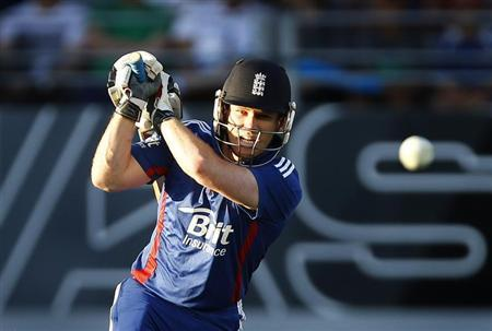 England's Morgan hits a boundary during their first Twenty20 cricket match against New Zealand in Auckland