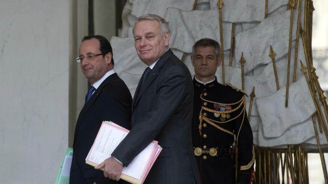 France's President Francois Hollande, left and Prime Minister Jean-Marc Ayrault, foreground, walk in the lobby following the weekly cabinet at the Elysee Palace in Paris, Wednesday, Jan. 9, 2013.  (AP Photo/Michel Euler)