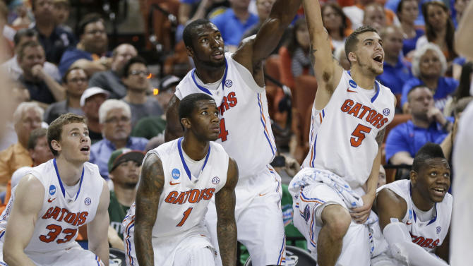 Florida's Erik Murphy (33), Kenny Boynton (1), Patric Young (4), Scottie Wilbekin (5) and Will Yeguete, right, watch on the bench during the final seconds of a second-round game of the NCAA men's college basketball tournament Friday, March 22, 2013, in Austin, Texas. Florida defeated Northwestern State 79-47. (AP Photo/Eric Gay)