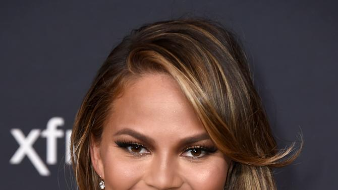 Chrissy Teigen arrives at the 4th annual NFL Honors at the Phoenix Convention Center Symphony Hall on Saturday, Jan. 1, 2015. (Photo by Jordan Strauss/Invision for NFL/AP Images)