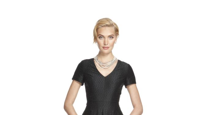 """This image released by Banana Republic shows a Black Jacquard Party Dress from a limited-edition collection designed by Banana Republic. Led by Creative Director and EVP, Simon Kneen, and styled and curated by """"Anna Karenina"""" costume designer Jacqueline Durran, the collection is currently available in Banana Republic stores. (AP Photo/Banana Republic)"""