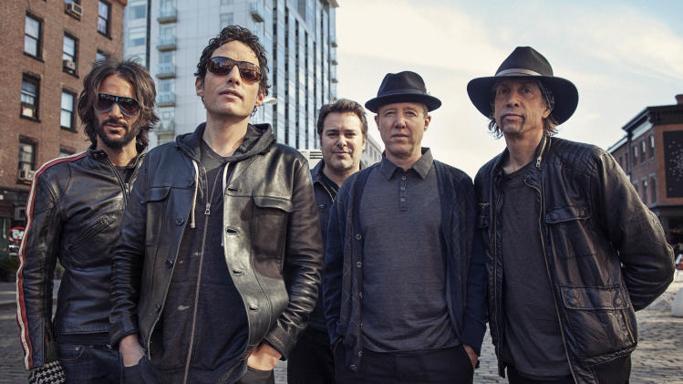 "This Oct. 1, 2012  photo shows members of The Wallflowers, from left, Rami Jaffee, Jakob Dylan, Greg Richling, Jack Irons and Stuart Mathis posing for a portrait  in New York. The Wallflowers released a new album this month titled, ""Glad All Over."" (Photo by Victoria Will/Invision/AP Images)"
