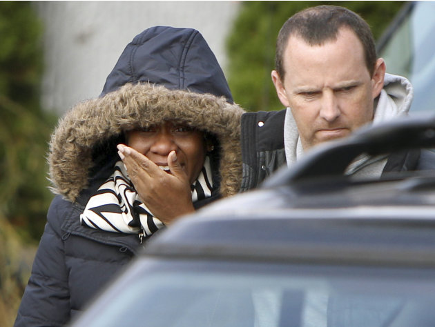 Glenda Moore, and her husband, Damian Moore, react as they approach the scene where at least one of their childrens' bodies were discovered in Staten Island, New York, Thursday, Nov. 1, 2012. Brandon