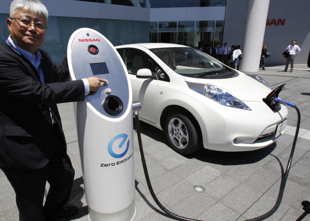 Nissan Motor Co. chief vehicle engineer Hidetoshi Kadota demonstrates a quick charge of a Nissan Leaf by a solar-assisted EV charging system at Nissan&#39;s global headquarters in Yokohama, Monday, July 11, 2011. Nissan is testing a super-green way to recharge its Leaf electric vehicle using solar power, part of a broader drive to improve electricity storage systems. In the new charging system, electricity is generated through 488 solar cells installed on the roof of the Nissan headquarters building. Four batteries from the Leaf had been placed in a box in a cellar-like part of the building, and store the electricity generated from the solar cells, which is enough to fully charge 1,800 Leaf vehicles a year, according to Nissan. (AP Photo/Koji Sasahara)