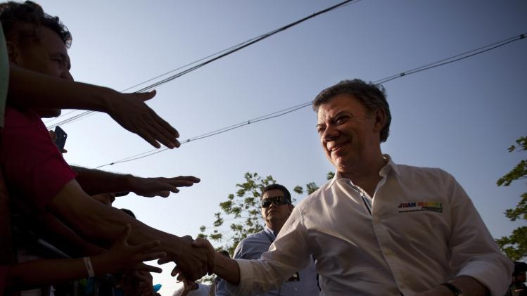 Colombia's President and presidential candidate Juan Manuel Santos greets supporters during the launch of his presidential campaign in Barranquilla