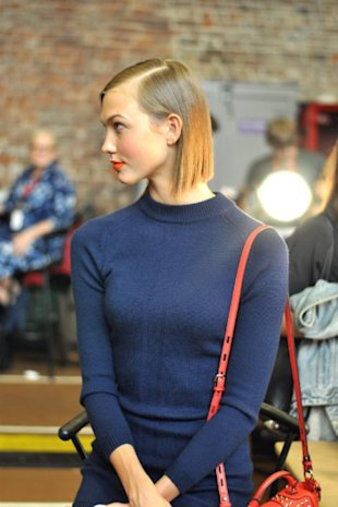 Model Karli Kloss backstage at DKNY with sleek hair