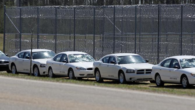 Hail-stone damaged Mississippi Department of Corrections vehicles are parked outside the fencing at the Central Mississippi Correctional Facility in Pearl, Miss. Tuesday, March 19, 2013.  Authorities say it's too early to know exactly how many structures and state agencies vehicles were damaged, but it appears to be widespread in parts of Jackson and its suburbs, with hail reported as big as baseballs pounding some spots. (AP Photo/Rogelio V. Solis)