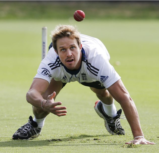 England's Nick Compton dives while at fielding practice ahead of the final cricket test against New Zealand