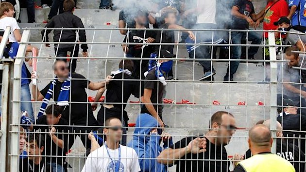 Supporters fight after Bastia's Gael Angoula and Ajaccio's French midfielder Johan Cavalli received a red card (AFP)