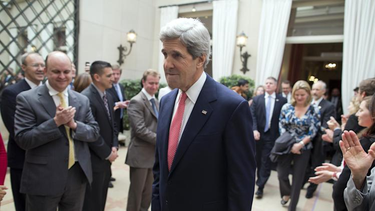 U.S. Secretary of State John Kerry arrives at the residence of Howard Gutman, US Ambassador to Belgium, to meet Tri-Mission staff on Monday, April 22, 2013, in Brussels, Belgium. Kerry is in Brussels for a meeting of NATO foreign ministers. (AP Photo/Evan Vucci, Pool)