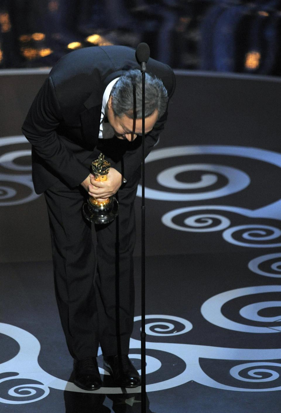 "Ang Lee accepts the award for best directing for ""Life of Pi"" during the Oscars at the Dolby Theatre on Sunday Feb. 24, 2013, in Los Angeles.  (Photo by Chris Pizzello/Invision/AP)"