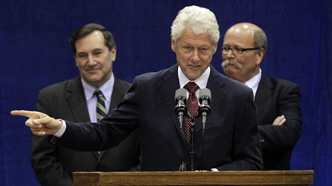 """Former President Bill Clinton speaks at a """"Hoosier Common Sense"""" rally for Indiana Democratic Senate candidate Joe Donnelly, left,  and Democratic Indiana gubernatorial candidate John Gregg, right, in Indianapolis, Friday, Oct. 12, 2012.  (AP Photo/Michael Conroy)"""