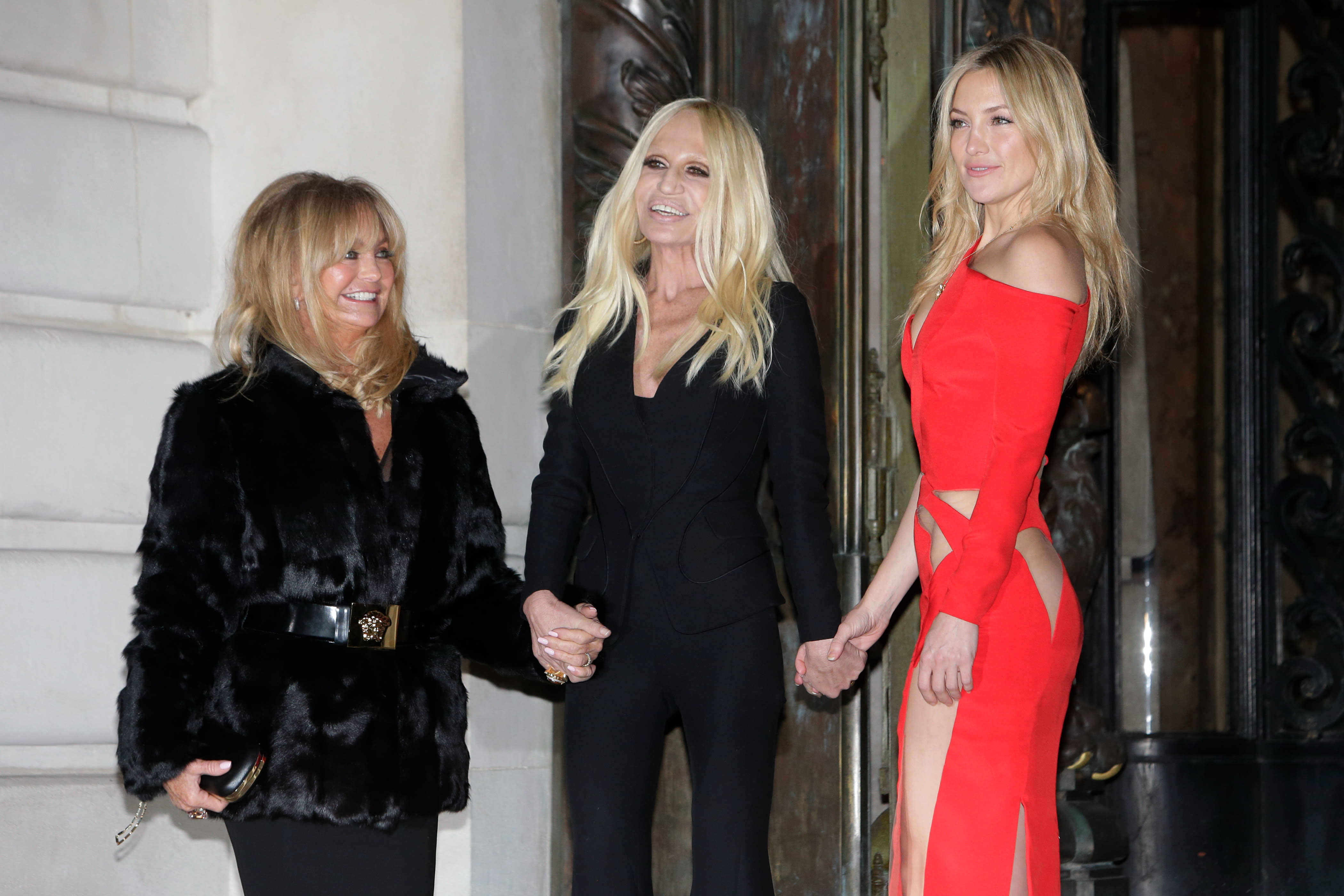 Kate Hudson reveals derriere at Versace, Portman hits Dior