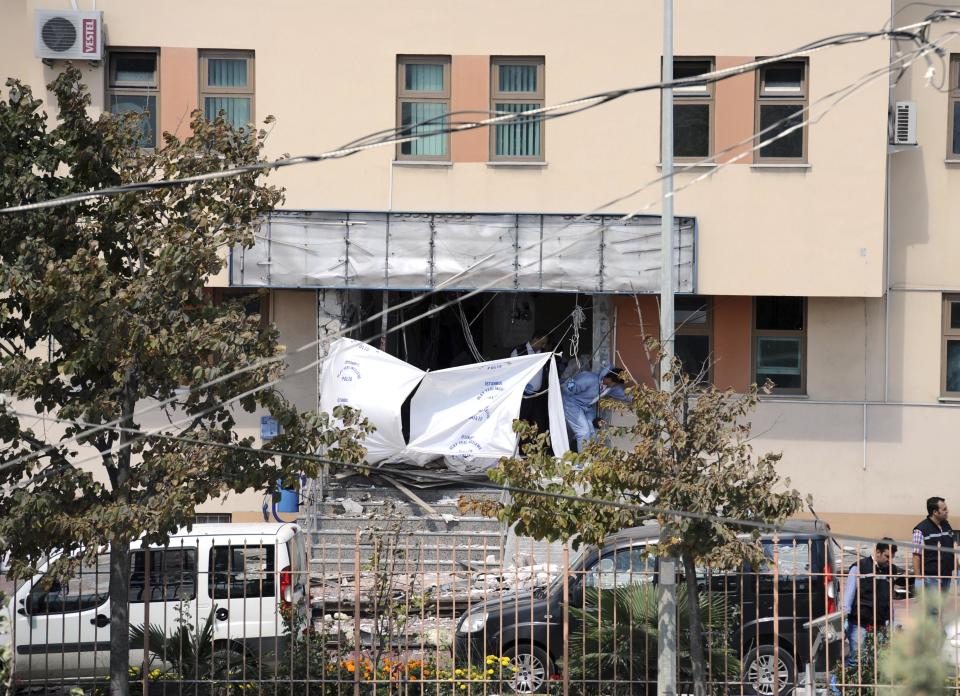 The entrance of police station seen after an explosion, in Istanbul, Turkey's biggest city, Tuesday, Sept. 11, 2012, A suicide bomber threw a hand grenade and blew himself up at a police station in Turkey's biggest city on Tuesday, killing one police officer and wounding seven other people, authorities said. (AP Photo)