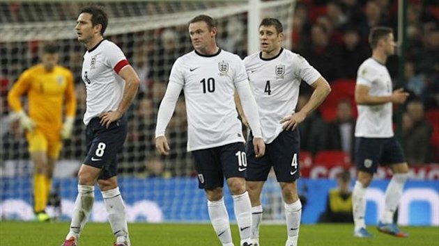England's Frank Lampard (L), Wayne Rooney (C) and James Milner during the defeat to Chile at Wembley (AFP)