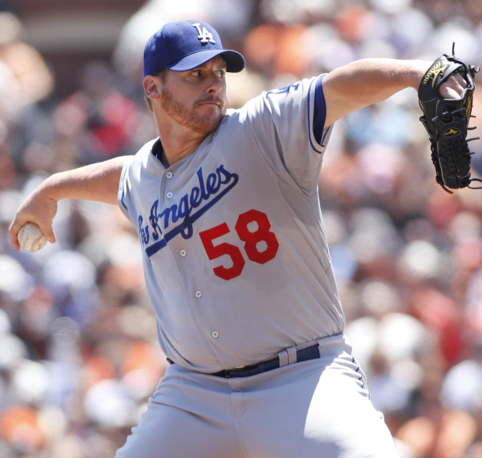 Los Angeles Dodgers pitcher Chad Billingsley throws to the San Francisco Giants during the first inning of a baseball game in San Francisco, Saturday, July 28, 2012. (AP Photo/George Nikitin)