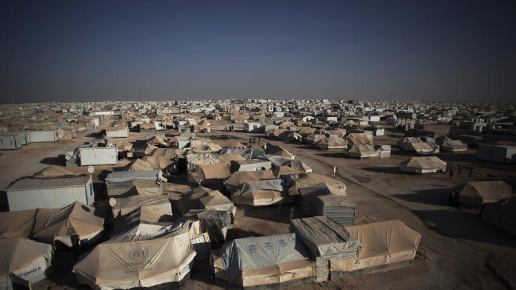 "FILE - This Wednesday, Oct. 23, 2013 file photo, shows a general view of Zaatari refugee camp near the Syrian border in Jordan. The United Nations says it is alarmed at ""violent nature"" of a demonstration in a massive Syrian refugee camp in Jordan that killed one person and wounded dozens. The U.N. refugee agency says a ""heated demonstration"" in Jordan's sprawling Zaatari refugee camp Saturday turned to ""a violent one"" after hundreds, possibly thousands of refugees started throwing rocks at a police post. (AP Photo/Manu Brabo, File)"