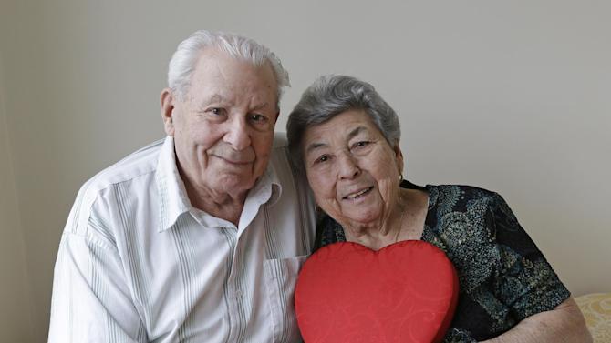 Fortunato Corso, 89, and Madalena Corso, 88, a Bensonhurst couple married 72 years, pose with a heart at their home in New York, Wednesday, Feb. 13, 2013.  On Thursday they'll be honored by Brooklyn borough President Marty Markowitz in a celebration of couples married 50 years or more.  The Corso's, who met as teenagers in Calabria, Italy, and married Feb. 4, 1941, have seven children, three girls and four boys. (AP Photo/Kathy Willens)