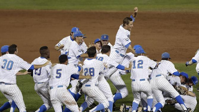 UCLA players pile up after defeating Mississippi State 8-0 in Game 2 to win the championship in the NCAA College World Series baseball finals Tuesday, June 25, 2013, in Omaha, Neb. (AP Photo/Nati Harnik)