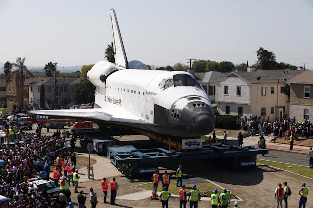 After more than 130 missions, the four remaining space shuttles of NASA's fleet found their way to their final resting places after being flown, placed on transport vehicles, and then hauled through streets to museums and science centers. (Patrick T. Fallon/AP Photo)