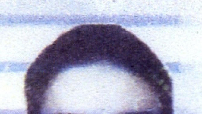 The photo released by the Berlin police Tuesday, Jan. 22, 2013 shows the picture of a forged Dutch ID card that was used by a man who rented the underground parking garage spot used to start the digging a tunnel into a city bank's safety deposit room. Unknown robbers dug a 30-meter (100-foot) tunnel into the safe deposit room of a Berlin bank and escaped with their haul, setting a fire as they left to cover their tracks. (AP Photo/Polizei Berlin)