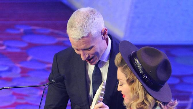 Singer Madonna presents CNN news anchor Anderson Cooper with the Vito Russo Award at the 24th Annual GLAAD Media Awards at the Marriott Marquis on Saturday March 16, 2013 in New York. Madonna presented CNN news anchor Anderson Cooper with the Vito Russo Award. (Photo by Evan Agostini/Invision/AP)